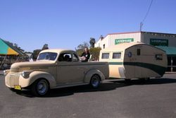 An Old GMC and Old Caravan during the Parade