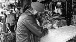 A stall seller at work, Shepherd's Bush Market