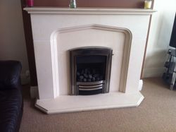 Inset Gas Fire an Limestone Fire Surround Installation. 4.