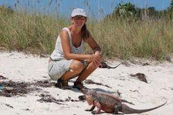 Ann with a friendly iguana
