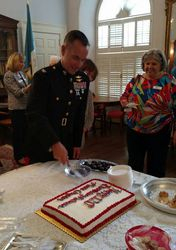 Col. Tom Clark cutting the birthday cake