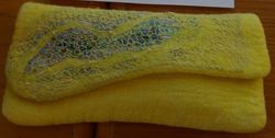Yellow felted clutch by Razaan Jakoet