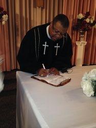 Pastor Signing Wedding License
