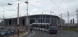 Flexity 013 departing Starr Gate depot