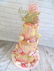 40th birthday gold and pink drip cake