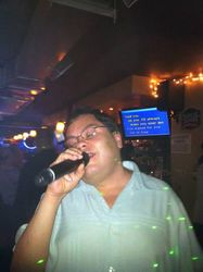 Kike doing it up for the crowd at Carmen & Patty's Birthday Celebration (502 Bar Lounge's Social Saturday Karaoke Night)!