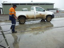 first vehicle being washed