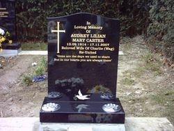 Black granite ogee top headstone with cross