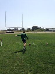 Jon kicking the ball.