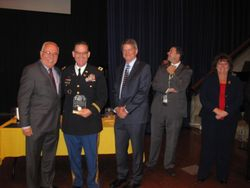 Colonel Bob Desousa receives honors for Colonel Harry H Clark