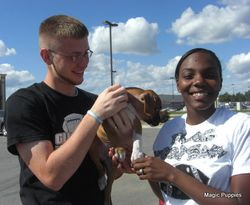 Chris and Morgan Hale with new Boxer Puppy Sam