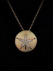 Diamond and gold sand dollar pendant