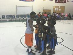 Junior coaches leading Flag Football Team Play!
