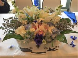 Floral Centerpiece In Suitcase