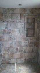 Shower surround with recessed shelf