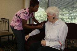 Nina, CNA taking a blood pressure