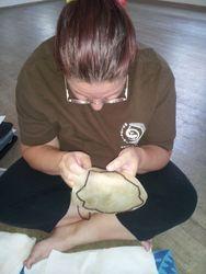 Making pūniu (knee drum)