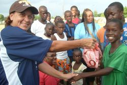 Barbara presenting balls to goal scorers from 1/2 time shoot out