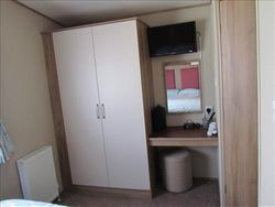 DOUBLE BEDROOM SHOWING WALL FITTED TV/DVD
