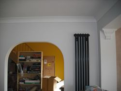 New arch, plaster and radiator.