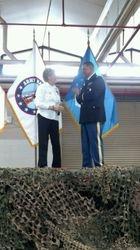 Pat Merville GSM coin presentation to Col. Garcia