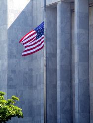 Close-Up of East Flag Outside North Façade of James Madison Memorial Building at Half Staff in Honor of Lying in Repose of Associate Supreme Court Justice Ruth Bader Ginsburg from Northwest