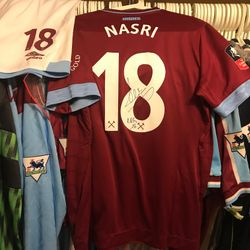 Samir Nasri worn and signed home shirt and shorts.