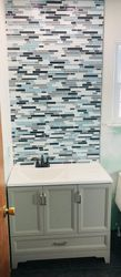 New vanity with tile back wall