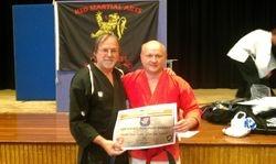 Presentation of Master Title and 4thDan Self Defence to Karl Grubis by Hanshi Claudio Artusi - Thurso June 2012