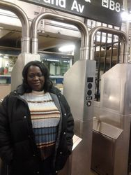 Patricia riding the train in Queens