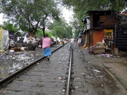 32 tracks clear as a blaring horn sounds, indicating a train is passing through the camp