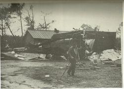 Mr. T.P. Lipscomb surveys damage