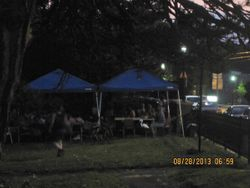 The crowd eating delicious BBQ as we set up in the church