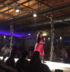 Miss Aimee receiving the People's Choice Designer award at DFW Teen Fashion Week 2016