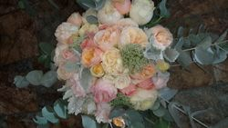 Soft pink and peach bouquet with blue gum