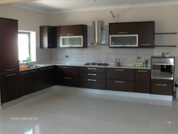 Modern kitchen in Wenge including appliances