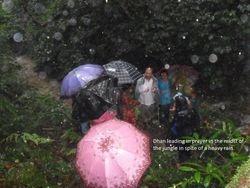 Dhan leading prayer in jungle rain- 2011