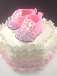Ruffled cake with baby shoe class