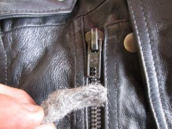 Use a small piece of wire wool to distress zip to match other zips on jacket