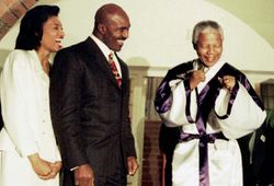 Mandela and Holyfield with his wife
