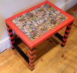 Superhero table with stripey legs.