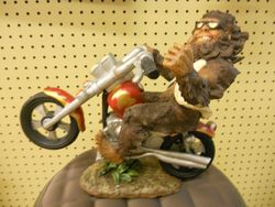Rick Rowley Art Sasquatch on Bike Wood Carving