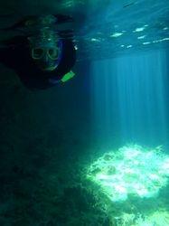 John snorkelling in Thunderball Grotto