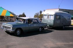 EH Holden and an Old Caravan during the Parade