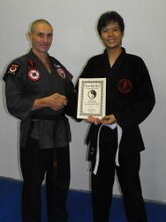 Andrew recieving his Encouragement Certificate and Stripes