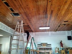 Father Christopher renovating ceiling