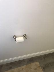 Installed toilet paper holder