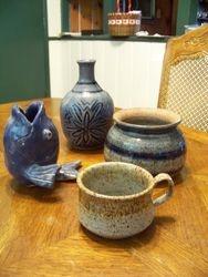 Ceramic fish, bottle, bowl, and mug.