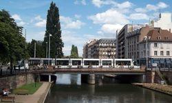 Alstom Citadis on a bridge crossing the Fosse du Faux Rampart