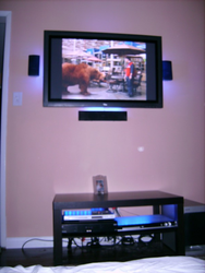 TV Mounted w/Light Attached & Surround Installed